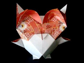 A cute origami owl with a beautiful pattern