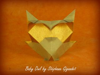 Origami owl with golden eyes