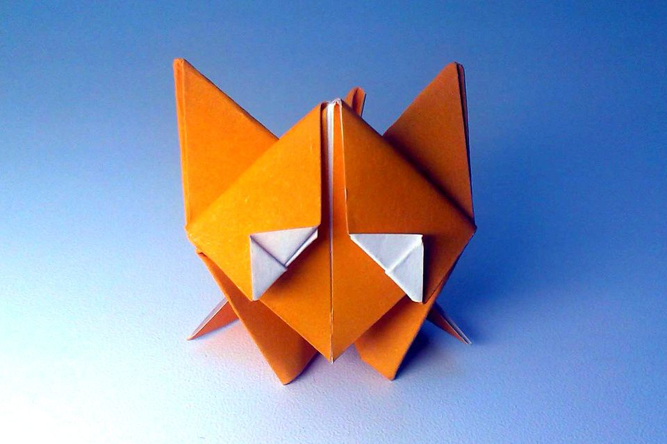 A Cute Origami Fox Standing On Ice