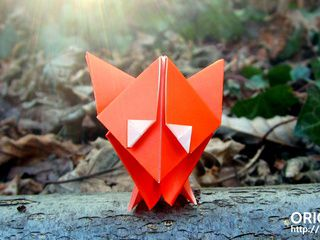 Cute origami fox in the woods