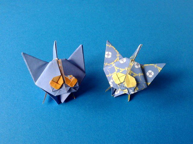 The origami kittens on a blue background.