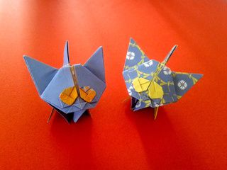 Two beautiful blue origami kittens