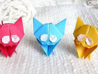 3 lovely origami kittens playing on a woolen sweater