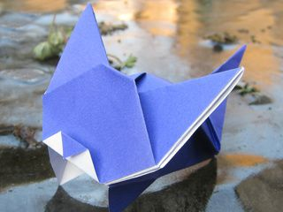Origami cat playing on icy lake