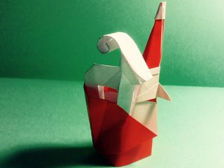 Origami Smiling Santa carrying a baby reindeer by Natalia Beccerra Cano