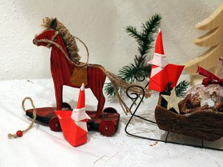 A very beautiful Christmas scene with 2 Smiling Santa Claus origami models