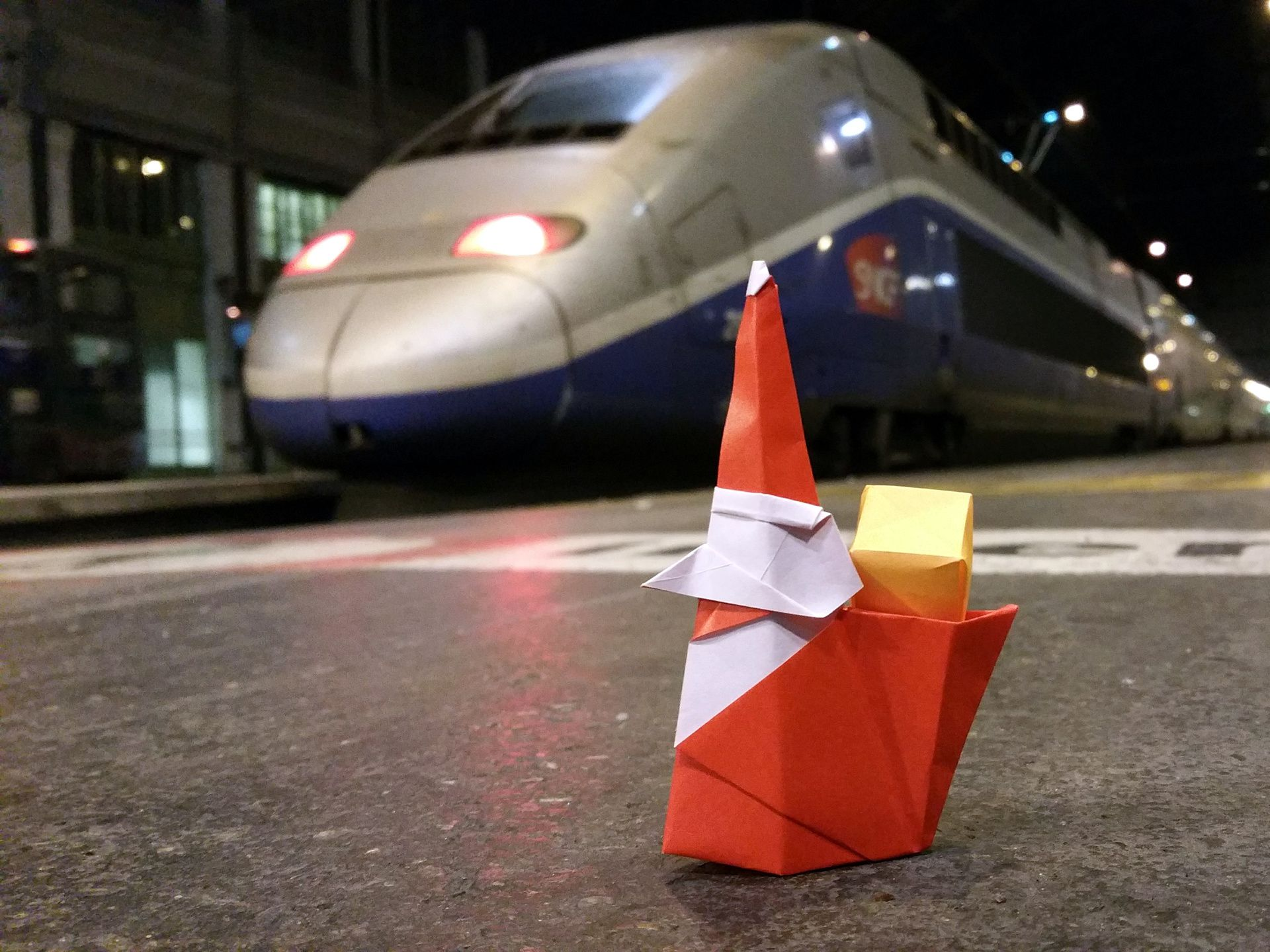 Origami Smiling Santa Claus Takes The TGV French High Speed Train