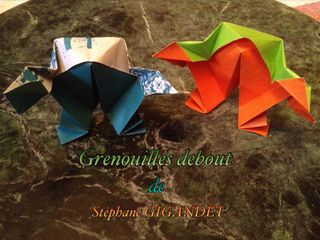 Two colorful origami frogs
