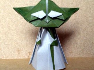 Origami Yoda in a white coat with his stick
